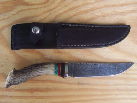 300 layer 1095 /15n20 ladder pat. blade Red coral, Malachite, White tail stag handle
